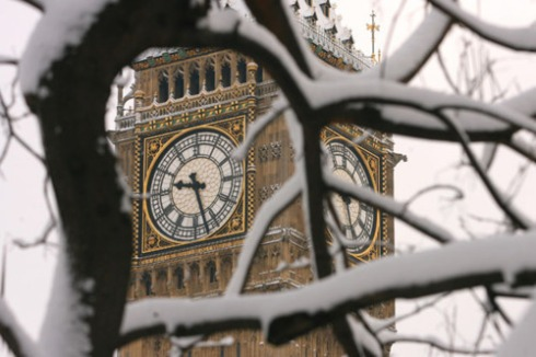 Snow covered trees surround Big Ben in central London on February 2,